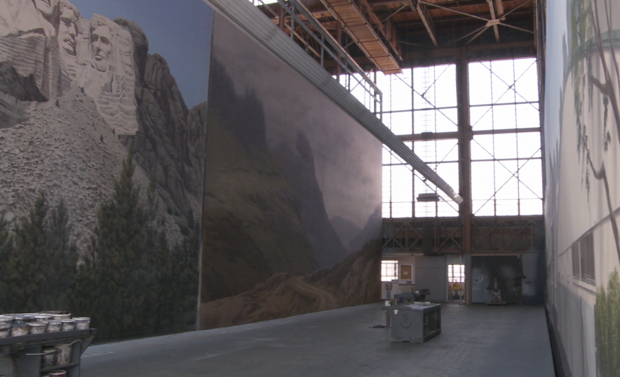 "For nearly 80 years scenic backdrops were painted for movies in this studio on the MGM lot.  In the left corner, a backdrop from ""North By Northwest"""